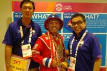 Volunteers with a Thai fan at 28th SEA Games