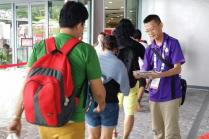 Volunteer distributing Safety Flash Cards at 28th SEA Games